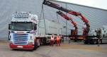 Cranes performing a tandem lift