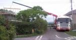 A long crane arm moving building supplies onto a building site