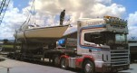A boat being transported on the back of one of our lorries