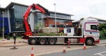 Heavy boulder being lifted at Lincoln college