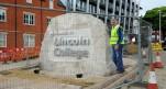 Installation of heavy boulder complete
